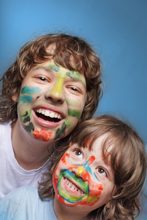 make dirty: two cheerful brothers with painted faces