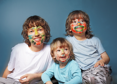 make dirty: three cheerful brothers with painted faces