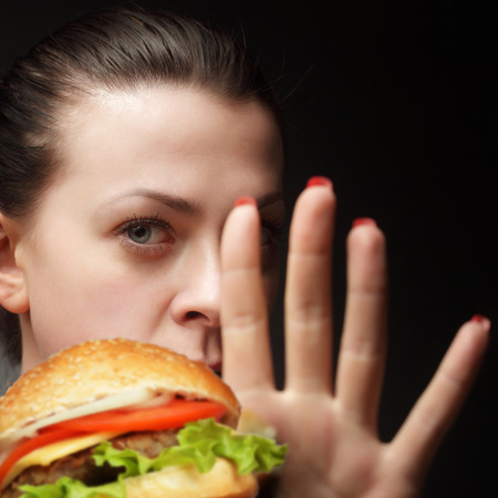 girl says stop junk food Stock Photo - 26743355