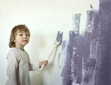 wall paintings: happy boy with paint brush