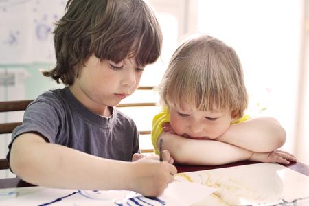 Children draw in home photo