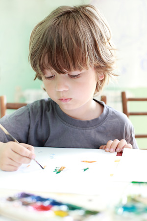 boy draw in home photo