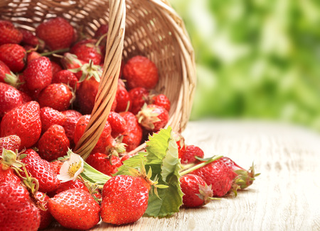 strawberry baskets: basket with strawberry on table