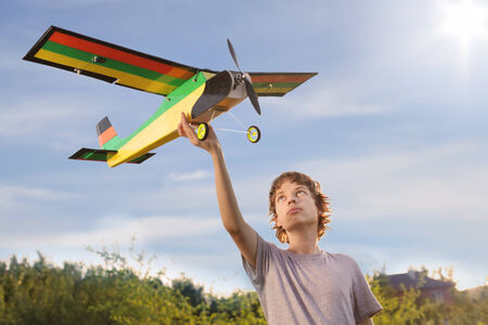Teen with homemade radio-controlled model aircraft photo