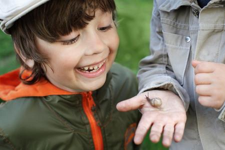 awe: children learn snail, focus on boy