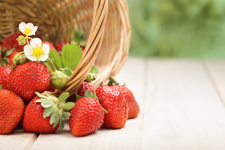 basket with strawberry on table photo