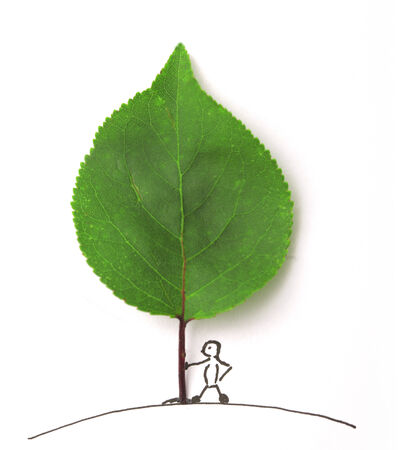 drow: green leaf and draw people on paper Stock Photo