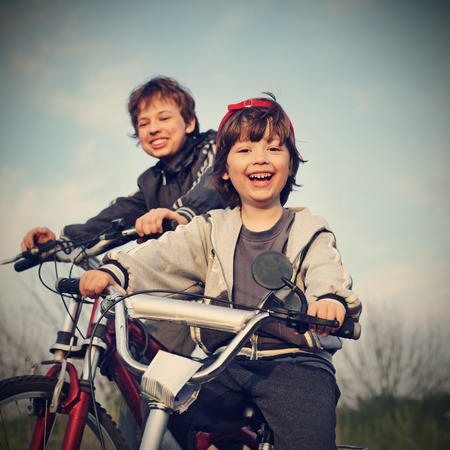 fun activity: two brothers ride bikes