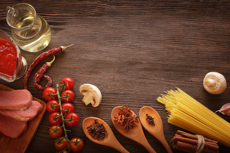 everything on wood table for the preparation of acute Italian sauce (tomato garlic spices olive oil) photo