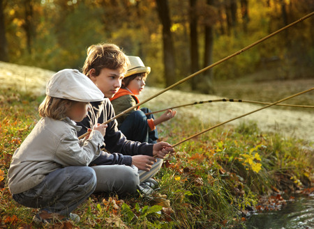 happy boys go fishing on the river photo