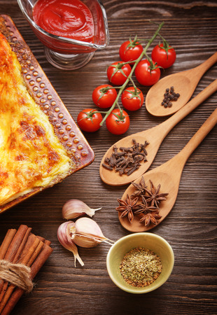 lasagna: ready lasagna and its ingradent on a wooden table