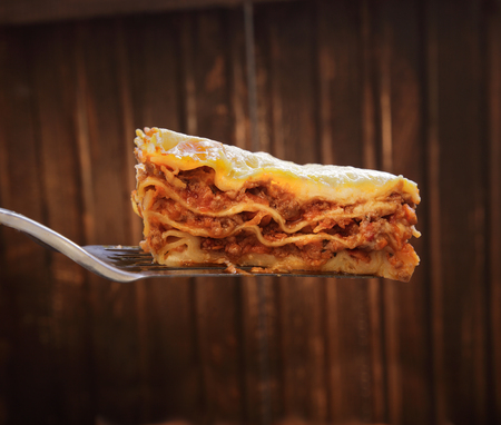 lasagna: ready lasagna on the blade on a wooden background