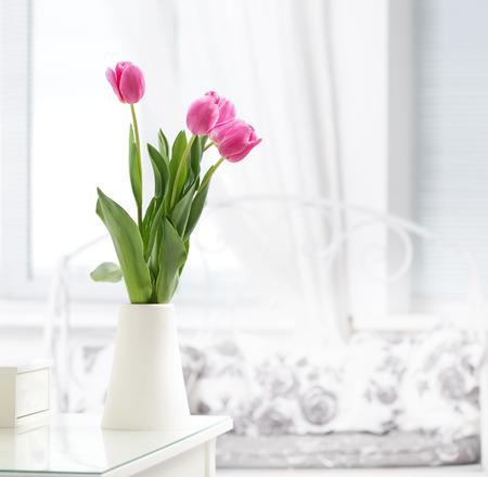 tulips in vase: pink tulip in whit room