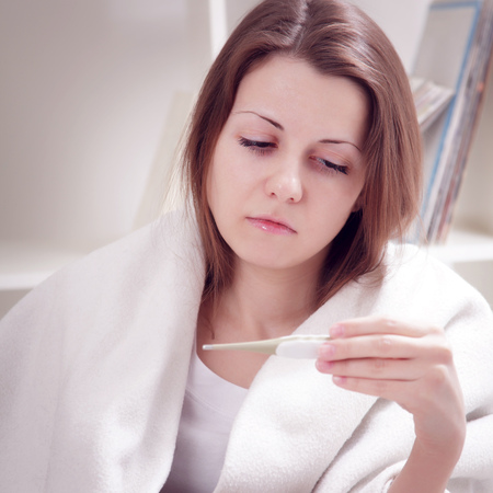 sniffles: girl measures the temperature of the body