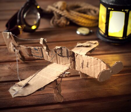 pilot light: hand made children airplane on wood table Stock Photo