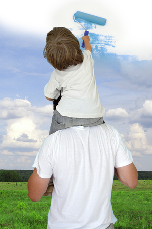 Dad helping son to draw good weather collage photo