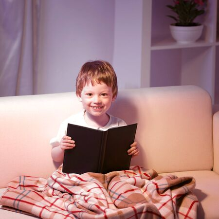 boy book: boy read book indoors