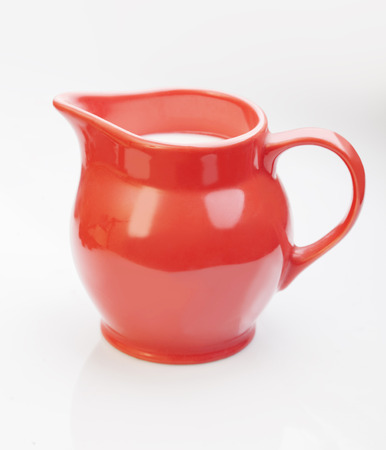 milk jug: red jug with milk isolate on white