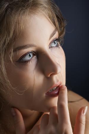 beauty girl cry on black background photo