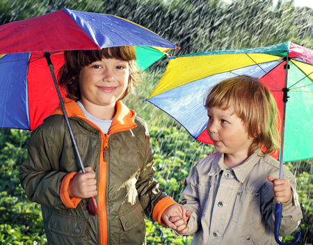 brother: two brothers play in rain outdoors