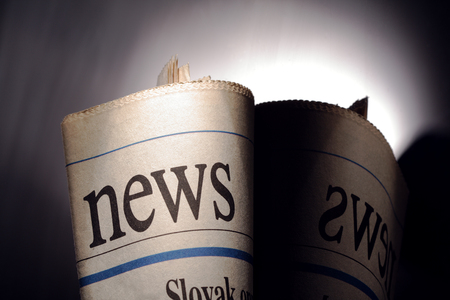 broadsheet: newspaper title on black background