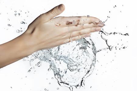 caucasian water drops: Splash of Water in Woman Hand Stock Photo