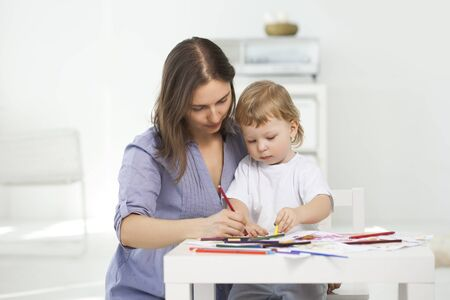 indoors: mother and son paint indoors Stock Photo