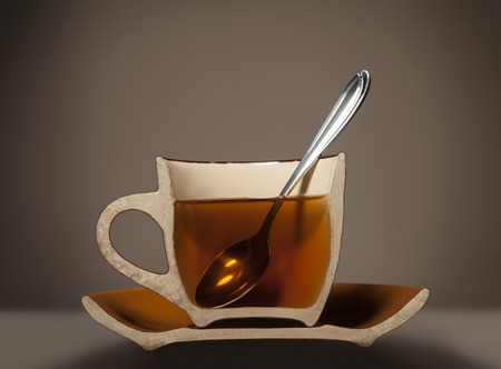 sawed: dissected half cup with tea and spoon