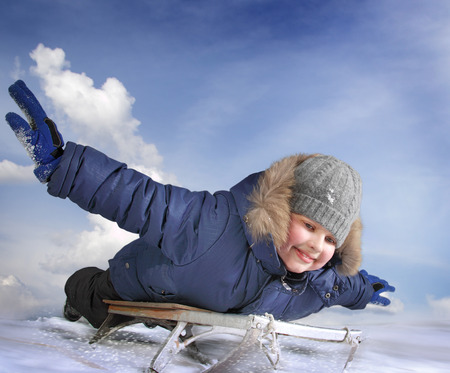 only teenagers: happy boy on sled Stock Photo