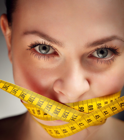 woman exercising: beauty girl with measure tape