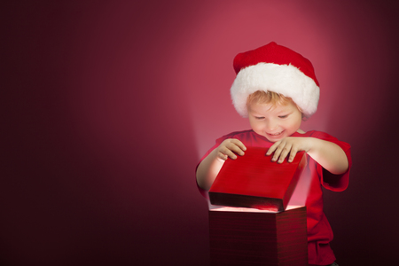 christmas hat: two happy boy open christmas gift-box