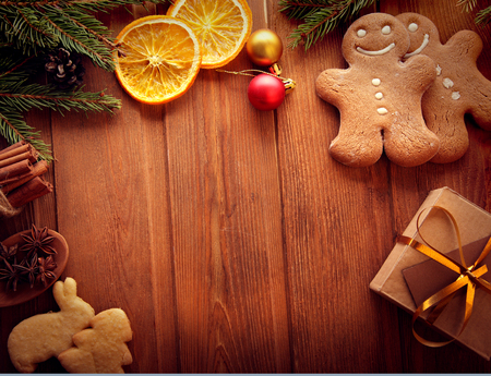 christmas cracker: gingerbread Christmas tree and gifts on wooden table