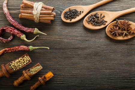 indian spices: Herbs and Spices over wooden background
