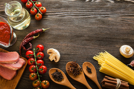 everything on wood table for the preparation of acute Italian sauce (tomato garlic spices olive oil) Stock Photo