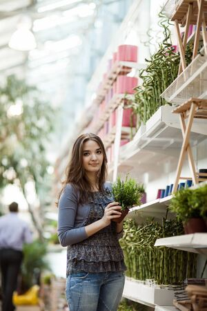 shoping: beauty girl shoping green plant Stock Photo