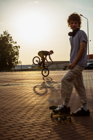teenager: teenager jump on a bicycle outdoors