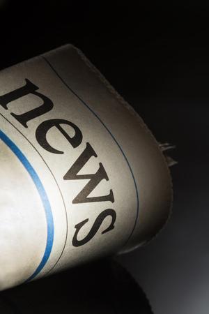 broadsheet newspaper: newspaper title on black background