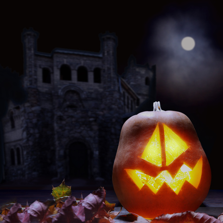 sinister: Jack o lanterns Halloween pumpkin face on sinister castle and moon background
