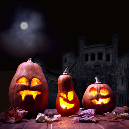 pumpkin face: Jack o lanterns Halloween pumpkin face on sinister castle and moon background