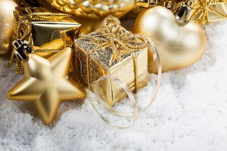 culture decoration celebration: gold christmas decorations on snow