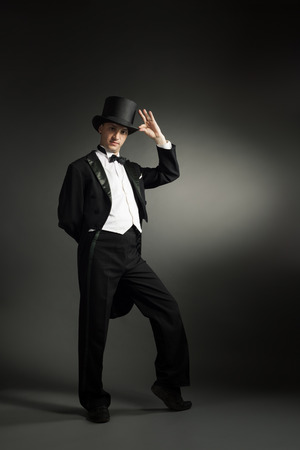 butterfly hand: tuxedo elegant man on a black background