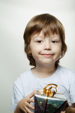baby boy: happy boy with christmas gift-box
