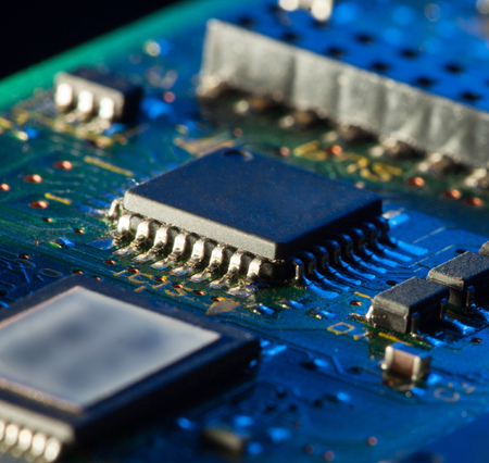 Circuit board with processor in blue light Stock Photo
