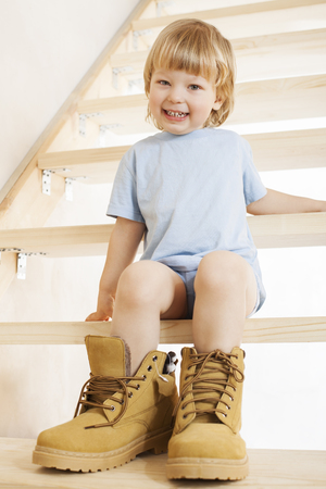 fill in: Big shoes to fill, childs feet in large shoe