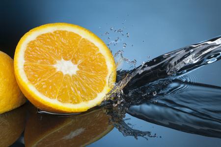 orange fruit: orange fruit slice in water stream