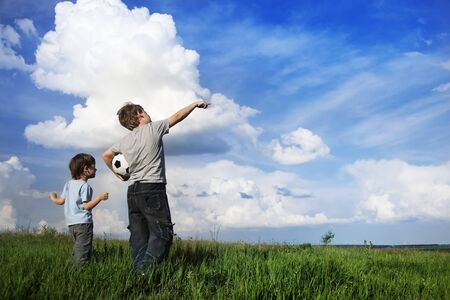 incredible: boy showing something to his friend in the clouds incredible miracle Stock Photo
