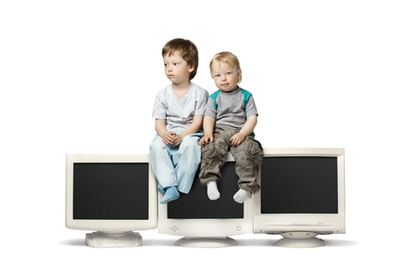 crt: boy sit on CRT monitor isolate on white