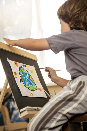 one room school house: Children draw planet earth in home