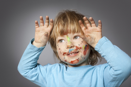 painted face: cheerful boy with painted face Stock Photo