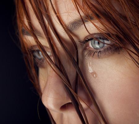 black eye: beauty girl cry on black background